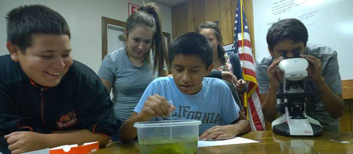 STEAM Students work on a science experiment